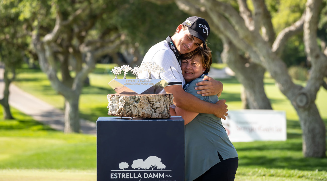 Christiaan Bezuindehout hugs his mother during the prize-giving ceremony of the Estrella Damm N.A. Andalucía Masters (credit © Real Club Valderrama)
